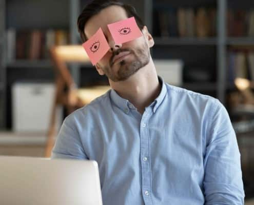 Exhausted,tired,businessman,with,painted,eyes,on,stickers,,adhesive,notes
